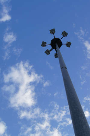 Street Light Poles against blue sky photo