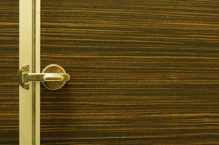 wood door with metal door latch photo
