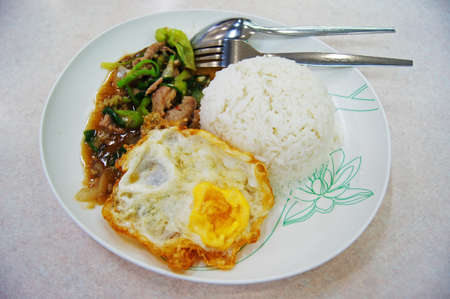 Fried pork with Paprika and Fried egg serve with rice ,Thai food photo