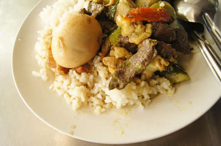 serv: chicken green curry and boiled egg serv with rice  Thai local food  Stock Photo