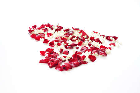 Rose petals in heart shape on white background photo