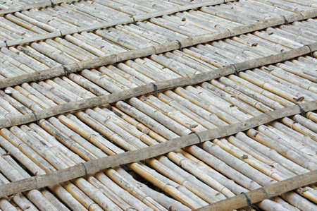 weaved: old bamboo litter used for drying fish