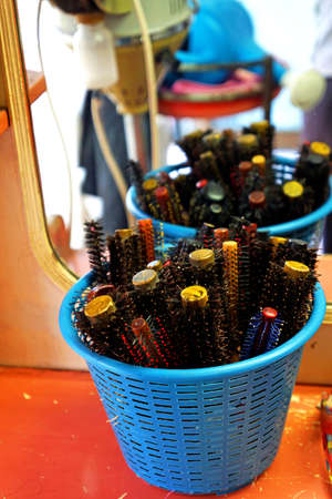 Old massage round hairbrush in a basket infront of the mirror of barber shop in local of Thailand Stock Photo - 21058049