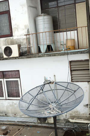 critical conditions: A broken satellite on the balcony of abandoned house