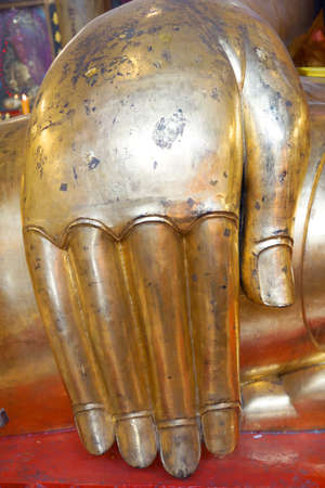 The hand of the big golden Buddha image at Wat Aupaipatikaram ,Chachoengsao,Thailand photo