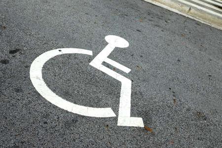 Disabled Parking Sign on asphalt floor in car park