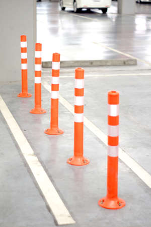 Orange Bollard inside carpark  photo