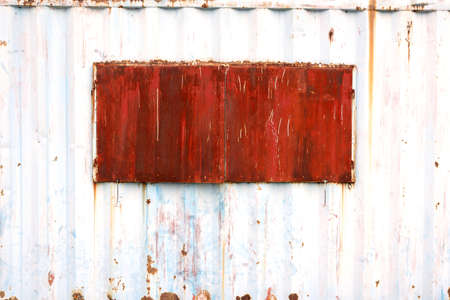 Rusty window of temporary shelter made by cargo container photo