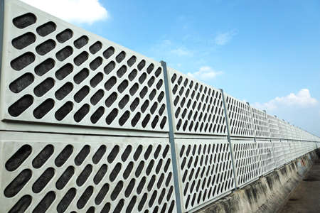 Noise barrier wall on the highway Stock Photo