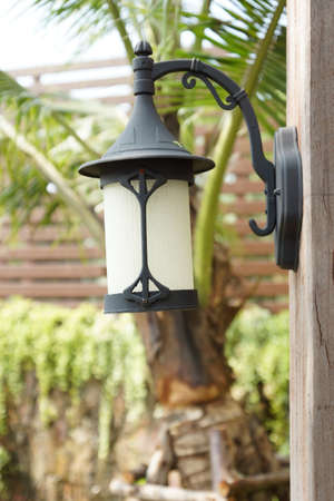 Vintage wall lamp in the garden photo