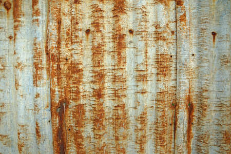 Rusty corrugated metal roof texture