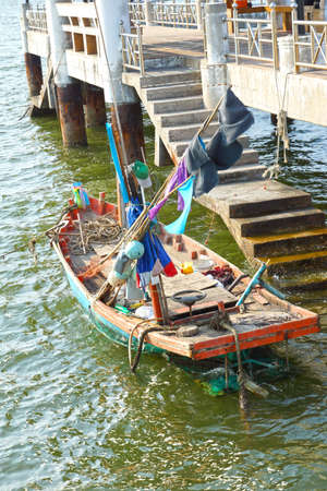 Wooden fishing boat near the port - Thailand photo