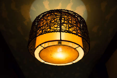 A round shaped vintage lamp on the ceiling photo