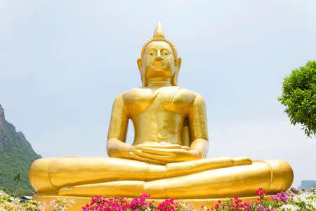 Big golden Buddha image in thai temple at Prachuap Khiri Khan province ,Thailand  Stock Photo