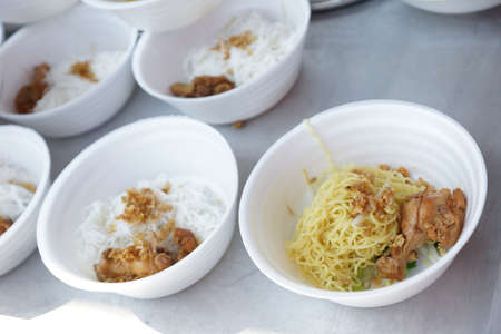 noodles with vegetables and chicken in bowl preparing for sale - Thailand market