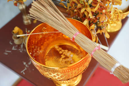 Holy water is used in religious ceremonies in Buddhism. Stock Photo