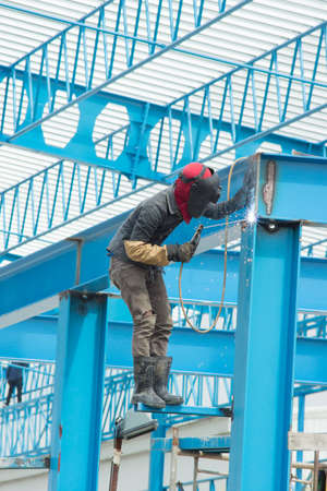 erecting: Craftsman welding working on metal structure Stock Photo