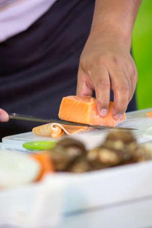Slicing Salmon - Japanese cuisine photo