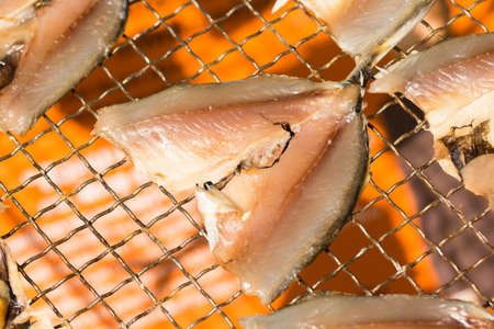 fishery products: Dried fish on metal net closeup