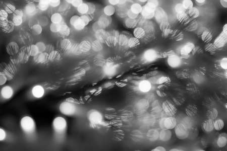 Blurry of Christmas LED lights decoration as abstract background - black and white photo