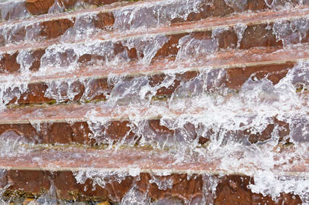 Water flowing from the stairs - stop motion Stock Photo