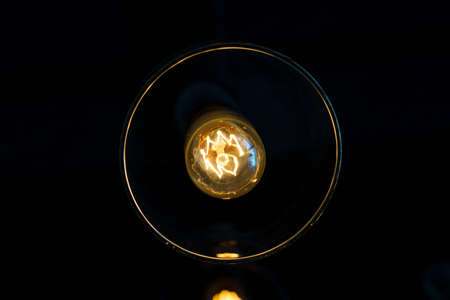 electric lamps hanging on the ceiling in the dark room - overhead view photo