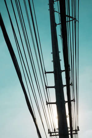 silhouettes of electric pole