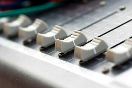 fader: Old buttons equipment in audio Mixing Console Stock Photo