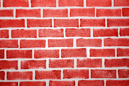 feature: painted white feature board for artificial red brick as background Stock Photo