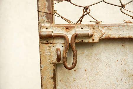 latch: old and rusty metal latch - retro scene