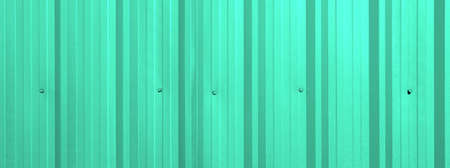 Corrugated sheet as background light green color photo