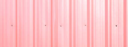 Corrugated sheet as background  pink color photo