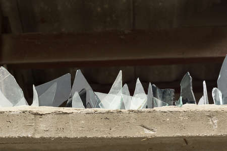 A wall with glass pieces for protection of intruders