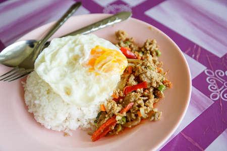serv: Thai fried pork in basil sauce serv with jasmin steam rice call as Pad Kaprao Moo in Thai name - Thailand street food Stock Photo