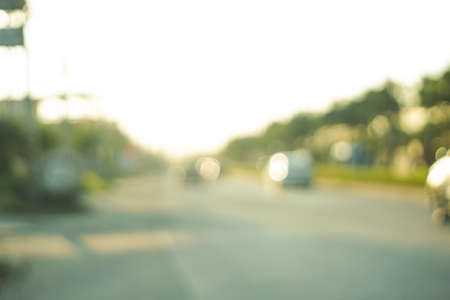 usage: blurry road scene in evening for background usage Stock Photo