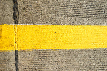yellow line: Concrete floor with traffic yellow line Stock Photo
