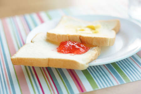 Bread with butter and jam - Simple breakfast Stock Photo