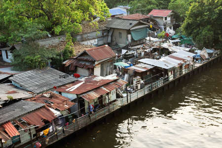 Urban ghetto house village canal side , Bangkok Thailand.
