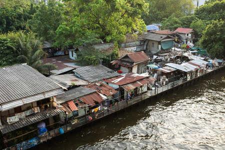 ghetto: Urban ghetto house village canal side , Bangkok Thailand.