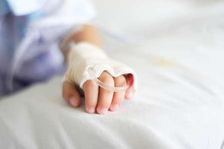 Saline intravenous (iv) drip in a Children's patient hand