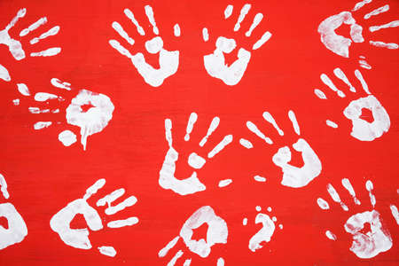 blood draw: White hands print on red color wooden sheet background