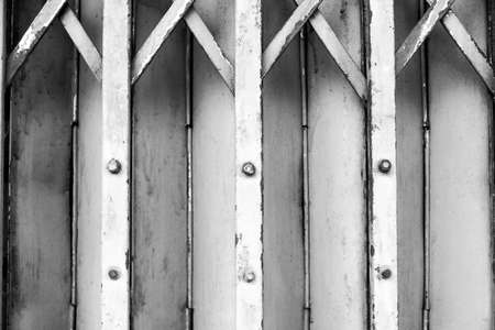 shutter door: Metal roller shutter door background - black ground