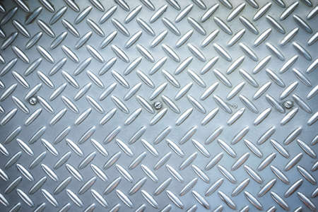 Used checkered steel plates background Stock Photo