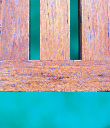 Part of Wooden slats table on blurry green turf for background and frame - Retro style Stock Photo