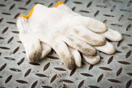 work gloves: Work gloves on metal sheet
