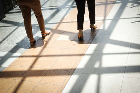 Business Women walking along the footway - Concept background