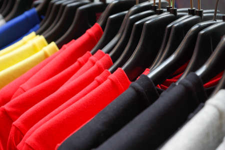 Cloth Hangers with colorful T-Shirts in the store