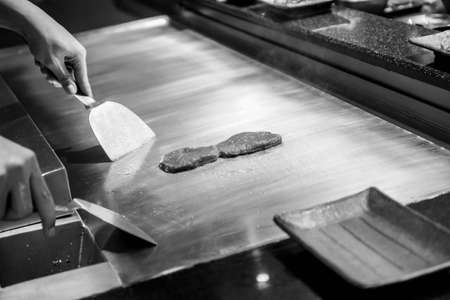 Chef cooking food - Black and White Stock Photo