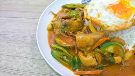 Spicy Stir Fried boar with Thai herbs served with jasmine steam rice and fried egg