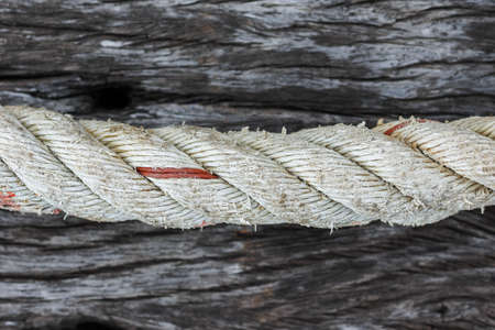 Old Ship rope on blurred old wooden background